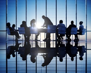 Silhouettes Of People In A Conference Room